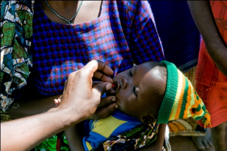 Administering Medication To Child At Madundas Clinic