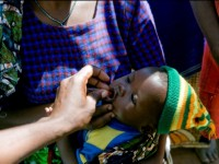 Administering Medication To Child At Madundas Clinic